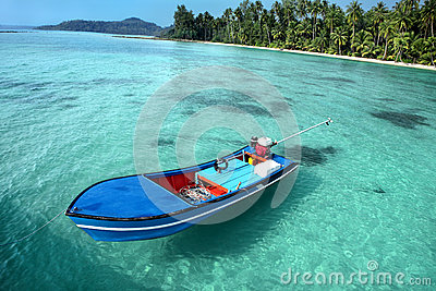 Motorboat, beautiful seascape with tropical beach and turquoise water