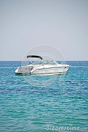 Motorboat in blue aegean sea