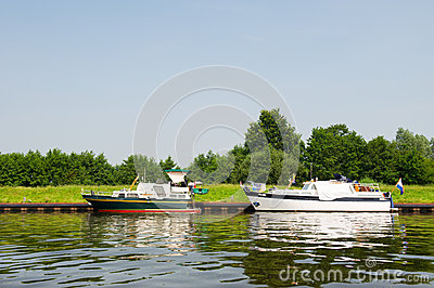 Motorboats in river