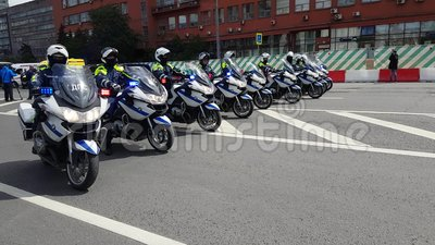 Motorcade of police motorcyclists is accompanied by a bicycle parade stock video footage