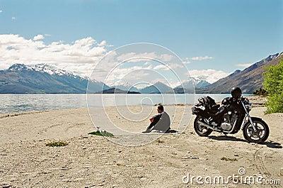Motorcyce rider on lakeside