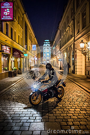 Motocycle at night in Wroclaw Editorial Stock Image