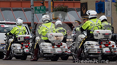 Motorcycle Police In Edmonton Editorial Stock Image