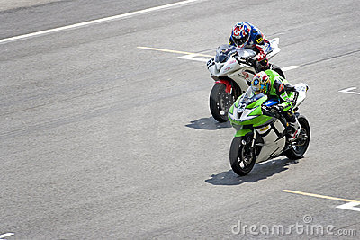 Motorcycle racers on track Editorial Stock Image