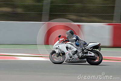A motorcycle runs at Montmelo Circuit de Catalunya, a motorsport race track Editorial Stock Photo