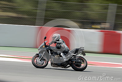 A motorcycle runs at Montmelo Circuit de Catalunya, a motorsport race track Editorial Photography