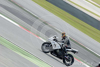 A motorcycle runs at Montmelo Circuit de Catalunya, a motorsport race track Editorial Stock Image