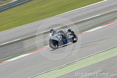 A motorcycle runs at Montmelo Circuit de Catalunya, a motorsport race track Editorial Image