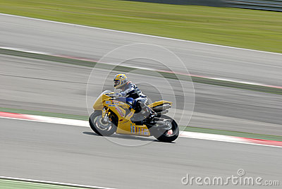 A motorcycle runs at Montmelo Circuit de Catalunya, a motorsport race track Editorial Photo