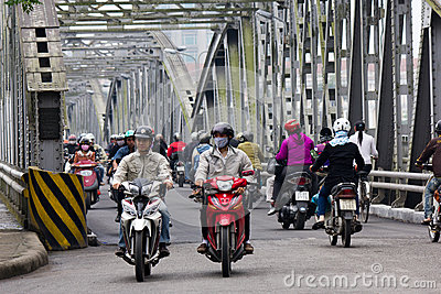 Motorcycle Traffic on a Steel bridge in Vietnam Editorial Stock Photo