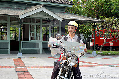 The motorcycle traveler front Train Station