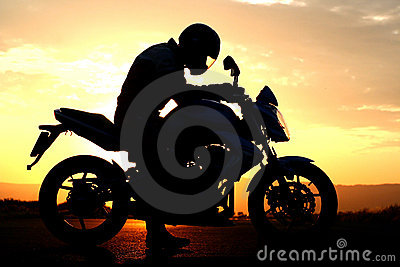 Motorcyclist silhouette at the sunset