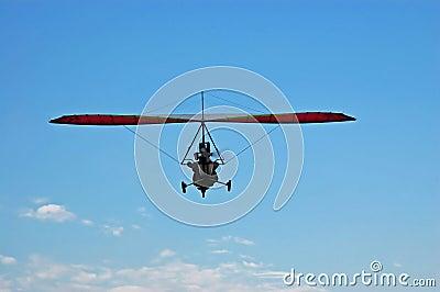 Motorized Glider in a blue sky