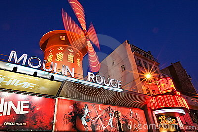 Moulin Rouge in Paris France - Motion Blur Editorial Stock Photo