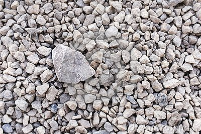 Mound of granite gravel, stones, crushed stone close-up. Rough seamless texture, construction material background Stock Photo