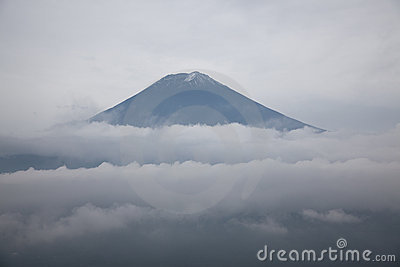 Mount Fuji summit over the clouds, Japan