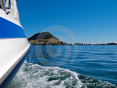 Mount Maunganui off bow of boat crossing harbour.
