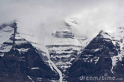 Mount Robson with snow and peak in clouds