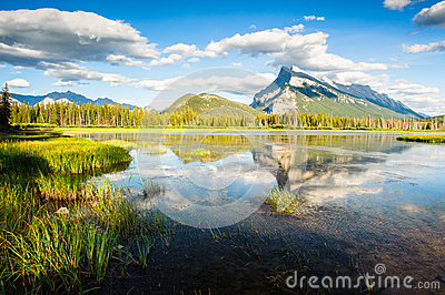 Mount Rundle with blue sky reflecting in Vermilion Lakes