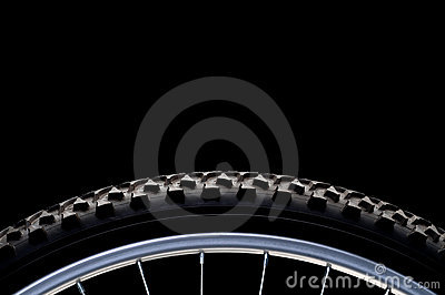 Mountain bike tire and rim on black