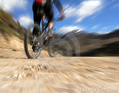 Mountain biker from behind, riding