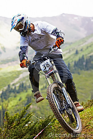 Mountain biker on downhill rce Editorial Photo