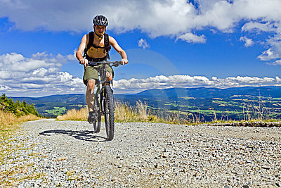 Mountain biker riding a bike in mountains