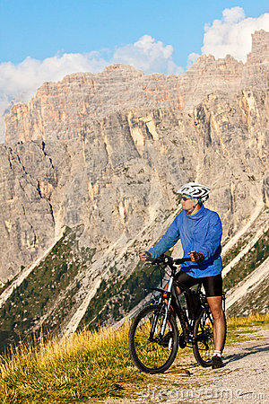 Mountain biker with rocky mountains