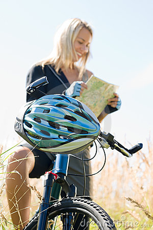 Mountain biking young woman search in map