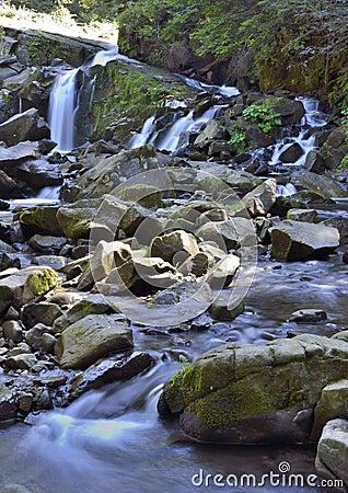 Mountain cascade at rocks