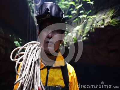 Mountain climber man in the uniform in the cave stock video footage