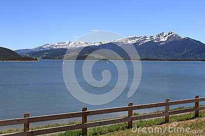 Mountain Lake with snow and fence