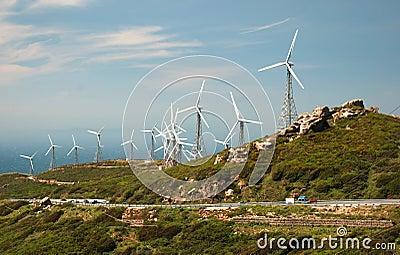 Mountain landscape with modern windmills