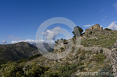 Mountain landscape with sardinian nuraghe