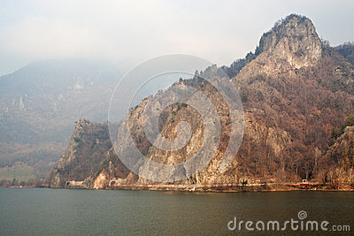 Mountain on Olt river with train passage