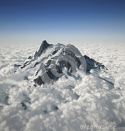 Mountain peak over the clouds