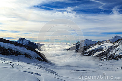 Mountain peaks above the clouds in Switzerland