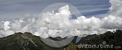 Mountain peaks and clouded sky panorama