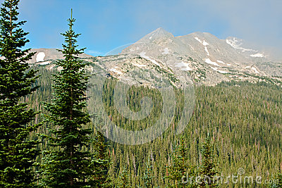 Mountain Peaks through Wispy Clouds
