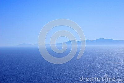 Mountain range at the coast in blue tones