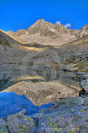 Mountain reflecting in a tarn (alpine lake)