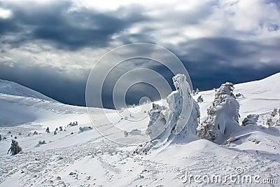 Mountain resort landscape under cloudy sky
