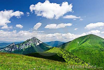 Mountain-ridge and blue sky with clouds