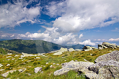 Mountain ridge and blue sky with clouds