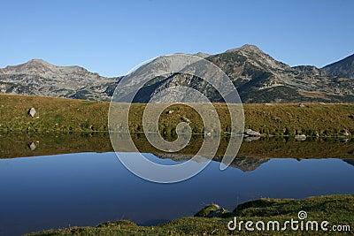 Mountain ridge reflection in a lake