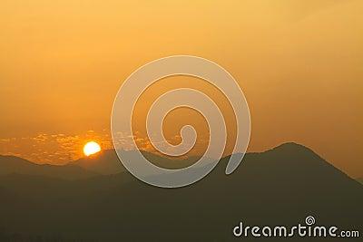 Mountain ridges under sunset