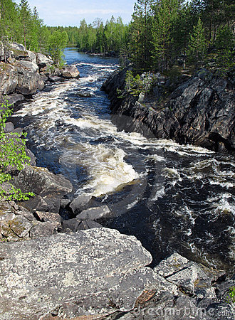 The mountain river in a canyon in Karelia (Russia)