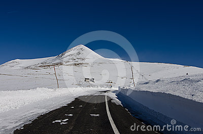 Mountain road blocked by snow