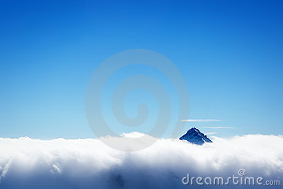 Mountain s top over clouds