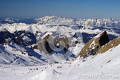 Mountain ski slope glacier austria with skiers
